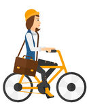 Woman cycling to work Stock Photo