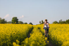 Woman is cycling royalty free stock photo