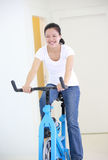 Woman cycling Stock Image