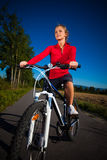 Woman cycling Royalty Free Stock Images