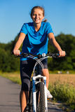 Woman cycling Royalty Free Stock Image