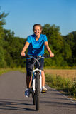 Woman cycling Stock Photography