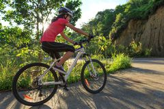 Woman cyclist cycling mountain bike Stock Photography
