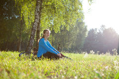 Woman cyclist enjoying relaxation in spring park Royalty Free Stock Photo