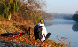Woman cyclist recreation on the river-side. Woman cyclist enjoy the recreation on the river-side. Beautiful scenic view Stock Photo