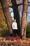 Woman cyclist relaxing in autumn nature Stock Photos
