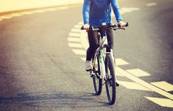 Woman Cyclist Riding Mountain Bike on city road Royalty Free Stock Photography
