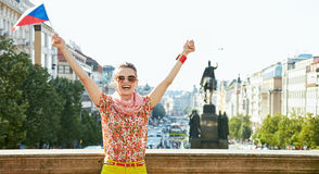 Woman with Czech flag rejoicing near National Museum in Prague Stock Photography