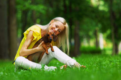 Woman dachshund in her arms Royalty Free Stock Photos