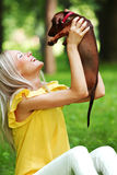 Woman dachshund in her arms Stock Images