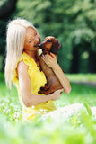 Woman dachshund in her arms Stock Photo