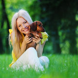 Woman Dachshund In Her Arms Royalty Free Stock Image