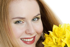 Woman with daffodils royalty free stock image