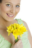 Woman with daffodils Stock Photos