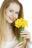 Woman with daffodils Stock Photography