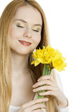 Woman with daffodils. Portrait of woman with daffodils Stock Photography