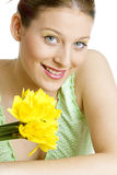 Woman with daffodils Royalty Free Stock Photo