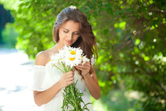 Woman with daisies Stock Photos