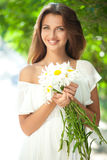 Woman with daisies Stock Image