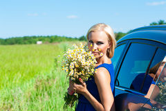 Woman with daisies in hands standing Royalty Free Stock Photography