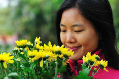 woman and daisy Stock Photo