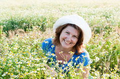 Woman on the daisy field Stock Image