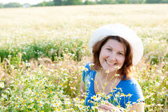 Woman on the daisy field Royalty Free Stock Image
