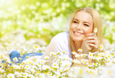 Woman on daisy field royalty free stock image