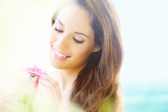 Woman With Daisy Stock Photography