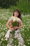 Woman with daisywheel bouquet Stock Photography