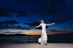 Woman dance on the beach Stock Photo