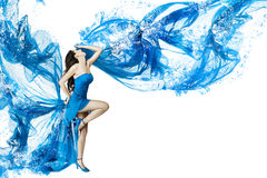 Woman dance in blue water dress. Dissolving in splash.  white Stock Image