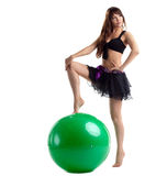 Woman in dance costume posing with green ball Stock Image