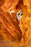 Woman Dance Fire, Fashion Girl Orange Dress Dancing Fabric. Woman Dance in Fire, Fashion Girl Orange Dress Dancing Fabric Flowing as Silk Flame stock photo