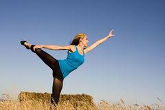 Woman in Dance Pose in a Field Stock Photography