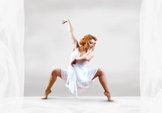 Woman dancer. Jump posing on background Royalty Free Stock Image