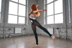 Woman dancer, in beautiful dynamic jump action figure Royalty Free Stock Photo