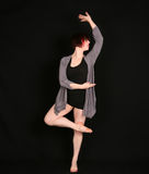 Woman dancer on black background Stock Image