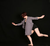 Woman dancer on black background Stock Photography