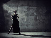 Woman dancer, concrete building surroundings Stock Image