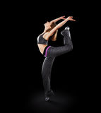 Woman dancer dancing modern dance, jump on a black Royalty Free Stock Image