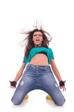 Woman dancer on her knees, shouting royalty free stock image