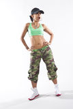 Woman dancer in hip hop attire striking a pose Stock Photography