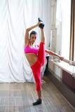 Woman dancer holding her leg Royalty Free Stock Image