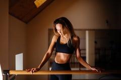 Woman dancer posing near barre in ballet studio. Beautiful woman dancer posing near barre in ballet studio Stock Image