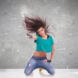 Woman dancer standing onher knees Stock Photo
