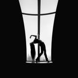 Woman dancer standing on window pane Royalty Free Stock Photography