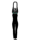 Woman dancer  stretching  exercises silhouette. One woman dancer stretching warming up exercises in studio silhouette isolated on white background Royalty Free Stock Photography