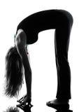 Woman dancer  stretching warming up exercises Stock Photos