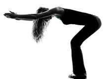 Woman dancer  stretching warming up exercises silhouette. One woman dancer stretching warming up exercises in studio silhouette isolated on white background Stock Photo